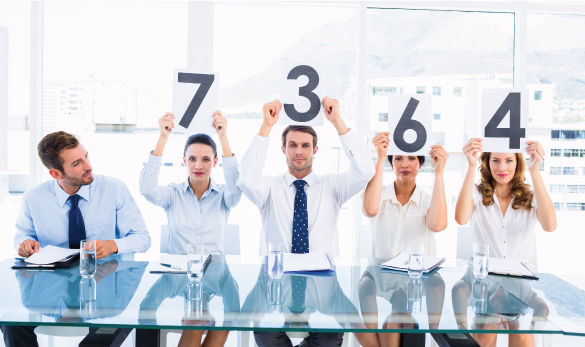 People Holding Up Scorecards